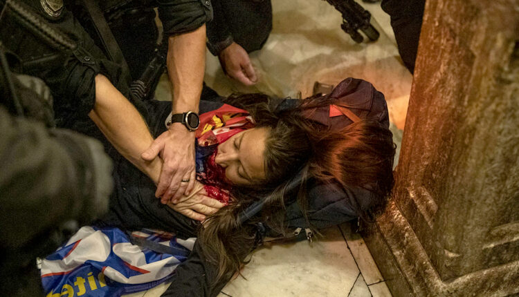 Law enforcement entities claim that the woman was shot by Capitol Police. Once shot and fell on the floor of the Capitol, police gathered around her trying to save her while calling for help, rioters all gathered around the female filming and shouting